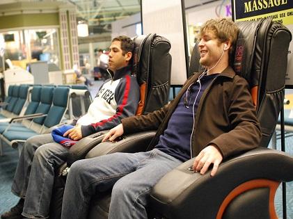 men sitting massage chair