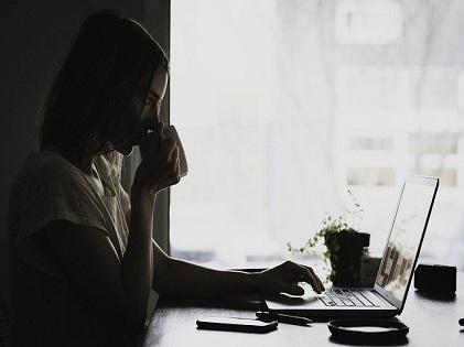 woman laptop drinking