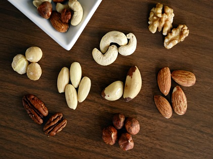 variety-of-brown-nuts-on-brown-wooden-panel-high-angle-photos