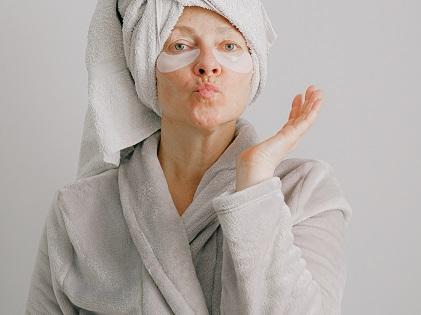 woman-in-gray-bathrobe-pouting